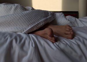 feet sticking out from under covers